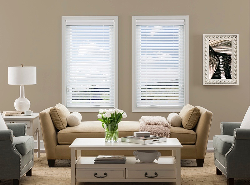 sofa under windows with blinds