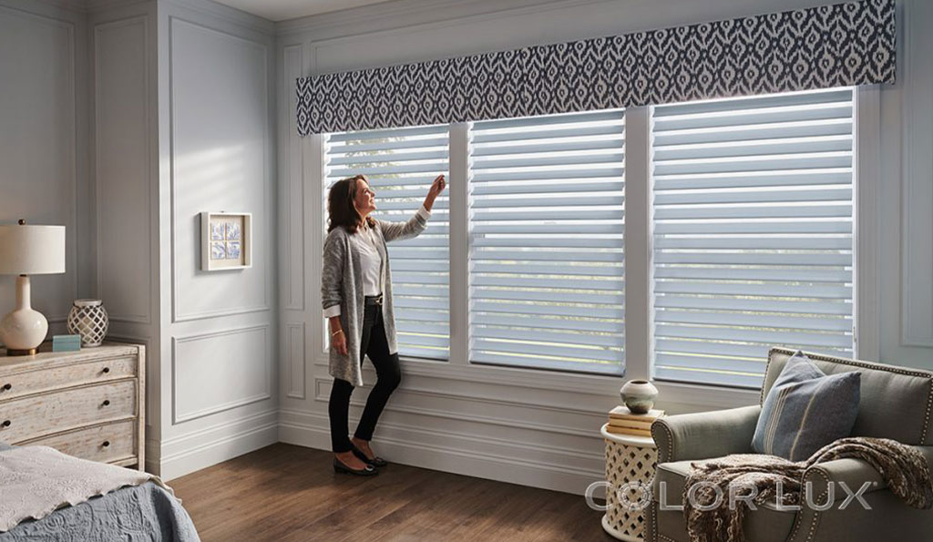 Woman smiling while opening her new blinds